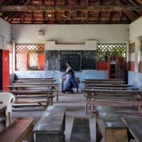 12 March 2020: A staff member inside an empty classroom of a school in Kochi, after the Kerala state government ordered schools across the state to close because of coronavirus fears. (Photograph by Reuters/ Sivaram V)