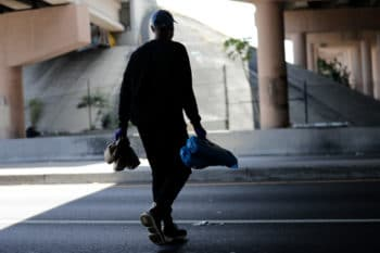 A volunteer delivers tents and meals to the homeless during the coronavirus pandemic in Miami, Florida, April 3, 2020. Lynne Sladky | AP