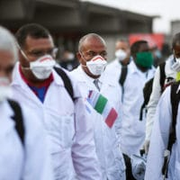 An emergency contingent of Cuban doctors and nurses arrive at Italy's Malpensa airport after traveling from Cuba to help Italy in its fight against the coronavirus. Daniele Mascolo | Reuters