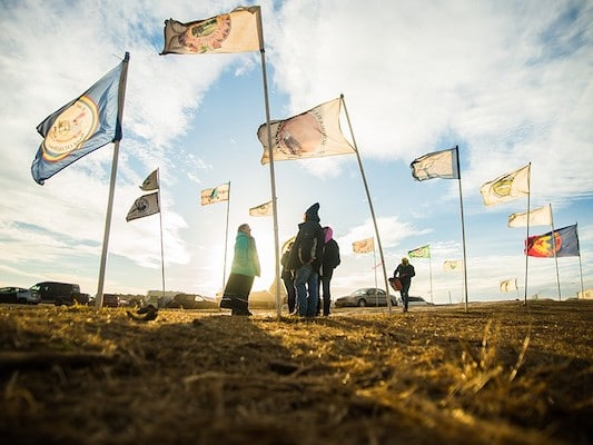 Flags fly at the Oceti Sakowin Camp in 2016, near Cannonball, North Dakota. LUCAS ZHAO / CC BY-NC 2.0