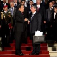 Igor Sechin, President of the Russian oil company Rosneft (R) being greeted by late Venezuelan President Hugo Chavez (L), self-styled leader of the 'Bolivarian Revolution' at doorstep of the presidential palace, Caracas, Sept 2012.