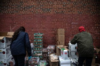 Volunteers prepare donations at a community outreach in Brooklyn, New York, March 20, 2020. OWong Maye-E | AP