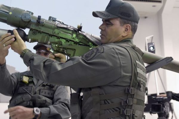 Vladimir Padrino Lopez holds an IGLA surface-to-air missile system in Caracas. Photographer: Juan Barreto/AFP via Getty Images
