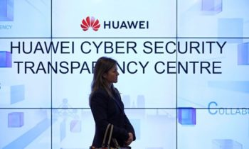 A woman listens to a debate at Huawei Cyber Security Transparency Center in Brussels, Belgium, on Jan. 30, 2020.(Xinhua/Zhang Cheng)