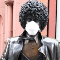 Title: Phil Lynott in a time of pandemic Caption: Statue of Thin Lizzy frontman Phil Lynott in Dublin city centre, during the coronavirus pandemic. Photo: Eamonn Farrell.