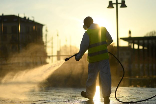 A worker sanitizes a street on the fourth day of an unprecedented lockdown across of all Italy