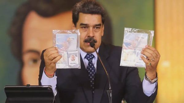 Constitutional President Nicolas Maduro shows the passports of the two U.S. Silvercorp mercenaries captured in Venezuela after the failed raid on Macuto. Photo: AFP