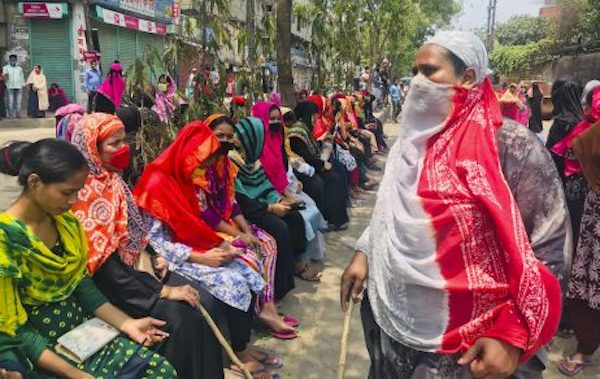 Bangladeshi garment workers block a road demanding their unpaid wages during a protest in Dhaka, Bangladesh, April 16, 2020. Credit: AP Photo/Al-emrun Garjon