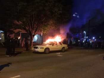 A police car burning in front of the police station in Richmond, Virginia on the evening of May 29.