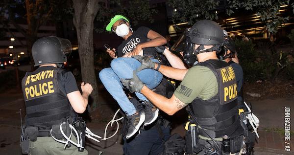 NLG Legal Observer arrested by Atlanta Police, June 1 (John Bazemore/AP).