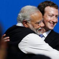 Facebook CEO Mark Zuckerberg, right, hugs Prime Minister of India Narendra Modi at Facebook in Menlo Park, Calif. Jeff Chiu | AP