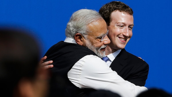 Facebook CEO Mark Zuckerberg, right, hugs Prime Minister of India Narendra Modi at Facebook in Menlo Park, Calif. Jeff Chiu | AP