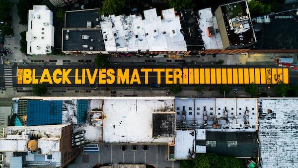 "A giant ""BLACK LIVES MATTER"" sign is painted in orange on Fulton Street, June 15, 2020, in Brooklyn, New York. John Minchillo | AP"