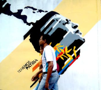   This is our great homeland Tenemos Patria Grande La Candelaria Caracas 2013 Passersby in front of a mural that references the vision of a free and united Latin America following the vision of José Martí and the Bolivarian Revolution Comando Creativo   MR Online