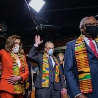 House Speaker Nancy Pelosi of Calif., House Majority Whip James Clyburn of S.C., and top Congressional Democrats raise their hands during a news conference to unveil policing reform and equal justice legislation on Capitol Hill, Monday, June 8, 2020, in Washington. (AP Photo/Manuel Balce Ceneta)