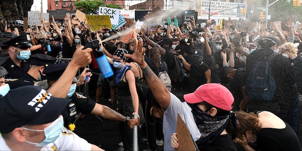 NYPD officers spray Mace into the crowd of protesters gathered at Barclays Center to protest the recent murder of George Floyd on May 29, 2020, in Brooklyn, New York. Photo: Kevin Mazur/Getty Images