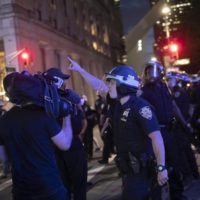 A police officer shouts at Associated Press videojournalist on June 2, 2020, in New York. Photo: Wong Maye-E/AP