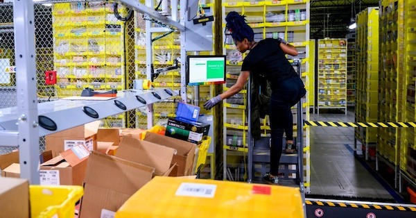 An Amazon employee works in the company's warehouse on Staten Island. (Photo: Johannes Eisele / AFP via Getty Images)