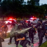 Violence employed by police and security agencies such as the FBI, which have devolved into occupying forces, to protect the exclusive interests of a tiny, ruling criminal class exposes the fiction of the rule of law and the treason of the ruling elites. (Photo by Michael Ciaglo/Getty Images)
