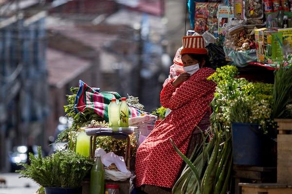 Herb and spice vendor working (despite the pandemic). Santa Cruz Street, La Paz, Bolivia, 2020. Carlos Fiengo
