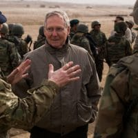 Senate Republican Leader Mitch McConnell, R-KY, speaks to a NATO Training Mission - Afghanistan advisor during a visit to meet Afghan National Army soldiers at Kabul Military Training Center Jan. 16, 2011.