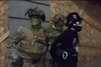 Unidentified, unmarked officers in military gear arresting a protestor in Portland, OR on July 16, 2020
