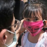   A father helps his child with a mask in front of Bradford School in Jersey City New Jersey on June 10 2020 AP PhotoSeth Wenig File   MR Online