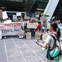 "Nanticha ""Lynn"" Ocharoenchai before the crowd at Climate Strike Thailand event in May. Photo: Nanticha ""Lynn"" Ocharoenchai / Courtesy"