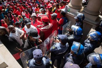 Madelene Cronjé, New Frame (South Africa), Police barricade the entrance to the City Hall during a march of thousands of members of Abahlali baseMjondolo protesting against political repression, Durban, 8 October 2018.