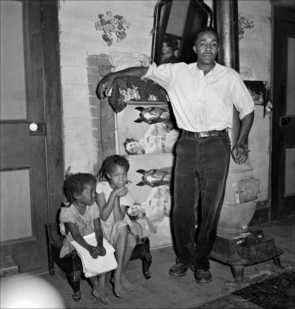 """""""Coal miner and two of his seven children. He has worked in the mines for about 20 years. Chaplin West Virginia. 1938."""" Photo by Marion Post Wolcott/Farm Security Administration-Office of War Information Photograph Collection Library of Congress."""