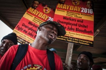 A member of the National Union of Metalworkers of South Africa (Numsa) sings during a May Day rally at Tembisa stadium on the periphery of Johannesburg, 1 May 2016 (Photo: John Wessels / AFP / Getty Images)
