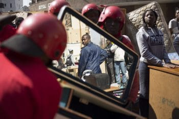 Eviction of 1,500 residents carried out by the 'Red Ants', a private security company whose name comes from the red outfits they wear during these removals, in Hillbrow, Johannesburg. 12 August 2015 (Photo: Cornell Tukiri / Anadolu Agency / Getty Images)
