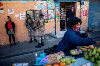 Street vendors at the Bara taxi rank during a joint patrol by the South African National Defence Force (SANDF) and the South African Police Service (SAPS) during the COVID-19 lockdown in Soweto, Johannesburg. 1 June 2020 (Photo: Michelle Spatari / AFP / Getty Images)