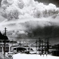 The bombing of Nagasaki as seen from the town of Koyagi, about 13 km south, taken 15 minutes after the bomb exploded. In the foreground, life seemingly went on unaffected. (Wikipedia)