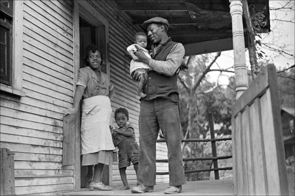 """""""Coal miner his wife and two of their children. Bertha Hill West Virginia. 1938."""" Photo by Marion Post Wolcott/Farm Security Administration-Office of War Information Photograph Collection Library of Congress."""
