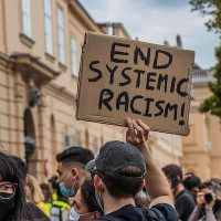 'End systematic racism' (Photo: Pikist)