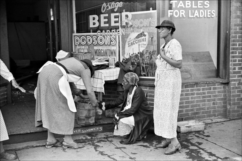 """""""Coal miners' wives making ice cream to sell on Saturday afternoon after payday. Osage West Virginia. 1938."""" Photo by Marion Post Wolcott/Farm Security Administration-Office of War Information Photograph Collection Library of Congress."""