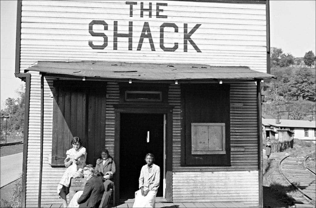"""""""Untitled. (The Shack a onetime church; milk is dispensed here. Relief clients wait for hours Scotts Run West Virginia. 1935.)"""" Photo by Ben Shahn/Farm Security Administration-Office of War Information Photograph Collection Library of Congress."""