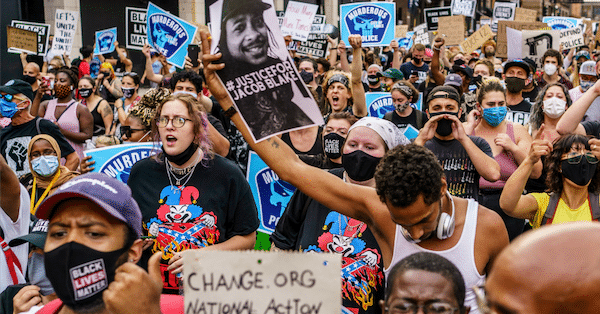 Protesters march near the Minneapolis 1st police precinct during a demonstration against police brutality and racism on August 24, 2020 in Minneapolis. (Photo: Kerem Yucel/AFP via Getty Images)