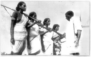 Mallu Swarajyam (left) and other members of an armed squad during the Telangana armed struggle (1946-1951). Sunil Janah / Prajasakti Publishing House.