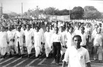 Communist leader Jyoti Basu (sixth from the left in the front row; no glasses), who later became the Chief Minister of West Bengal, at a Bhukha Michhil ('procession of the hungry'), during the Food Movement of 1959. Ganashakti