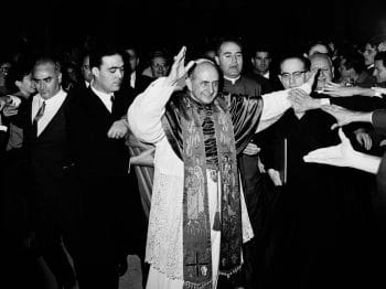 Pope Paul VI is surrounded by Opus Dei personnel near Italy's International Center for Working Youth, Nov. 21, 1965. Gianni Foggia | AP