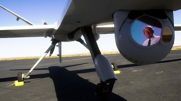 Thomas J. Cassidy, Former President and CEO of General Atomics, is reflected in the camera gimbal on a prototype Predator B, Sept. 6, 2001 in El Mirage, Calif. Doug Benc | AP