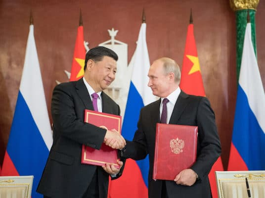 "Russian President Vladimir Putin (R) and Chinese President Xi Jinping (R) signed the statements on the ""comprehensive strategic partnership of coordination for a new era"" and on ""strengthening contemporary global strategic stability"", Moscow, June 5, 2019"