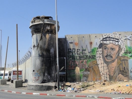 Qalandia Checkpoint, the biggest crossing in Jerusalem municipality from one side of the separation wall to the other. Photo courtesy of the Socialistische Partij, Netherlands/Flickr.