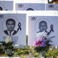 Images of more than 100 doctors who have died during the pandemic are displayed outside the Medical College of Peru PHOTO: AFP
