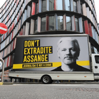 """A mobile advertising board with a """"Don't Extradite Assange"""" message outside the Old Bailey, London"""