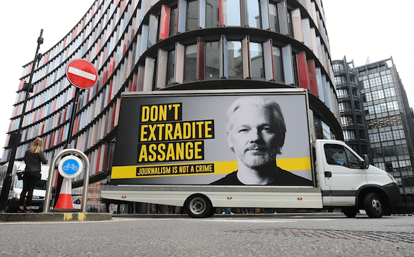 "A mobile advertising board with a ""Don't Extradite Assange"" message outside the Old Bailey, London"