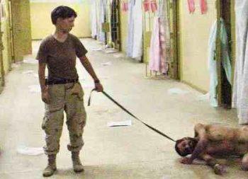 U.S. soldier photo from Abu Ghraib of a man on a leash
