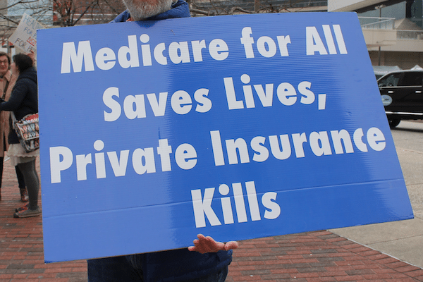 | Demand SINGLE PAYER Expanded Improved Medicare for All HR 676 Now Protest at the Baltimore Convention Center on Pratt at South Charles Street in Baltimore MD on Saturday morning 11 February 2018 Photo Elvert Barnes Photography | MR Online